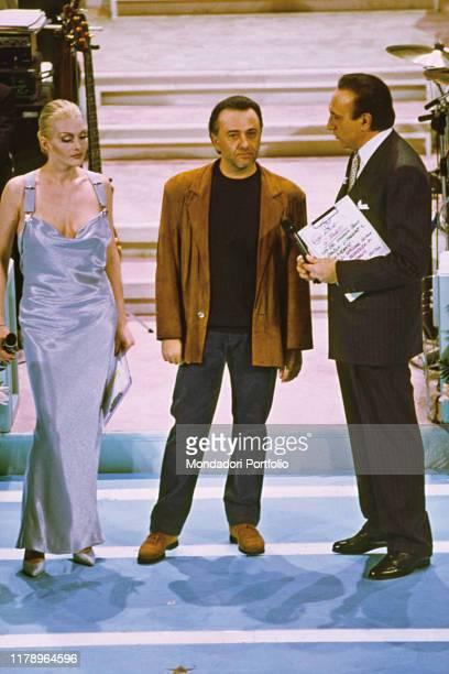 Italian comedian Giorgio Faletti Italian host Pippo Baudo and Italian singer Anna Oxa at the 44th Sanremo Music Festival Sanremo February 1994