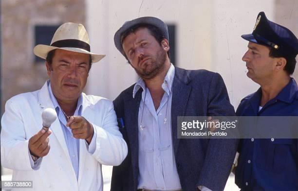 Italian comedian Lino Banfi acting in a scene of the film Il commissario Lo Gatto with Italian actor Maurizio Micheli as the journalist Vito Ragusa...