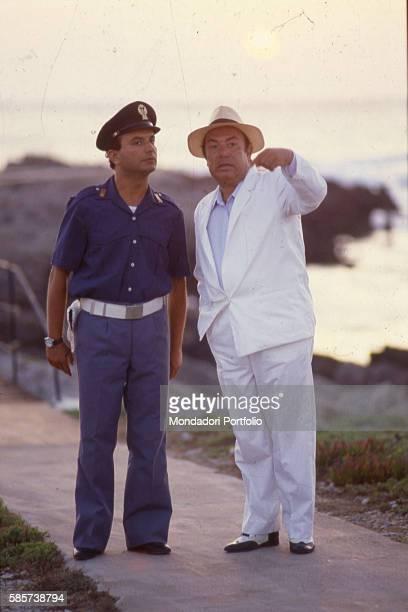Italian comedian Lino Banfi and Italian actor Maurizio Ferrini as the officer Gino Gridelli in a scene of the film Il commissario Lo Gatto Italy 1987
