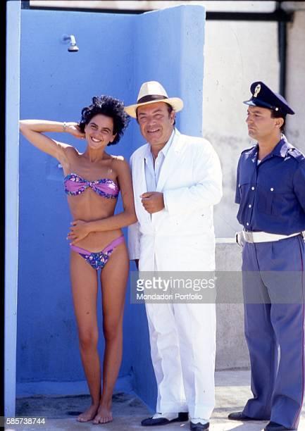 Italian comedian Lino Banfi posing on the set of the film Il commissario Lo Gatto with Italian actress Valeria Milillo playing Manuela Belluggi and...