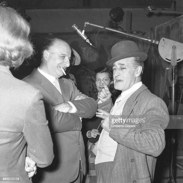 Italian comedian Totò is with Italian film director Camillo Mastrocinque during the shooting of 'Totò Peppino and the outlaws' Italy 1956
