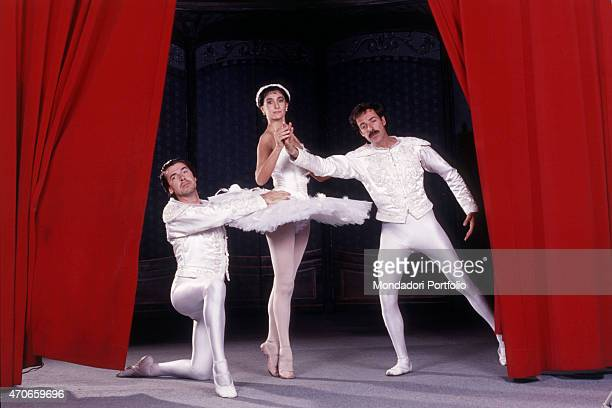 """""""Italian comedians Tullio Solenghi, Anna Marchesini and Massimo Lopez, dressed as ballet dancers on the stage of a theater, posing to present their..."""