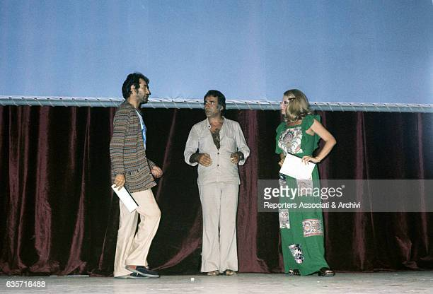 Italian comedy actor and TV host Walter Chiari talking on the stage with the Italian actor and dubber Alberto Lupo and the Italian actress Sylva...
