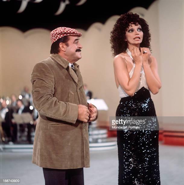 Italian comedy actor Carlo Dapporto and cuban actress Chelo Alonso are together involved in presenting the TV music show E perché no into the studios...