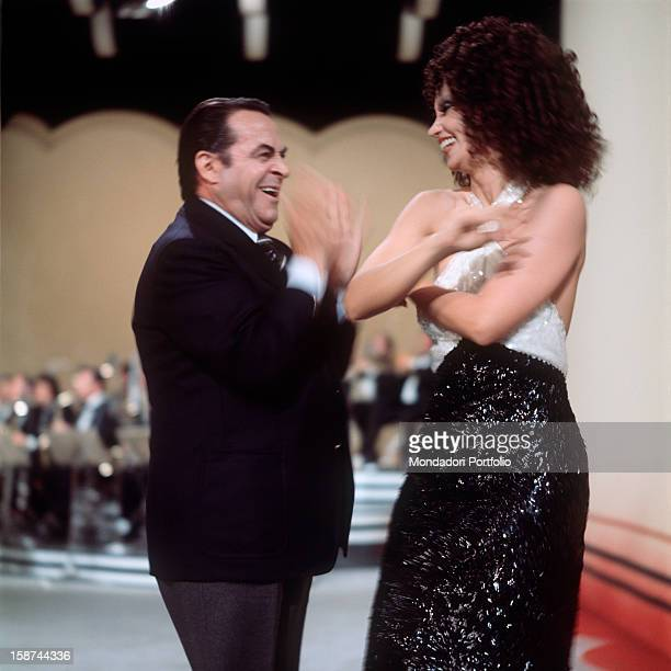 Italian comedy actor Carlo Dapporto jokes with cuban actress Chelo Alonso the two artists are together involved in presenting the TV music show E...