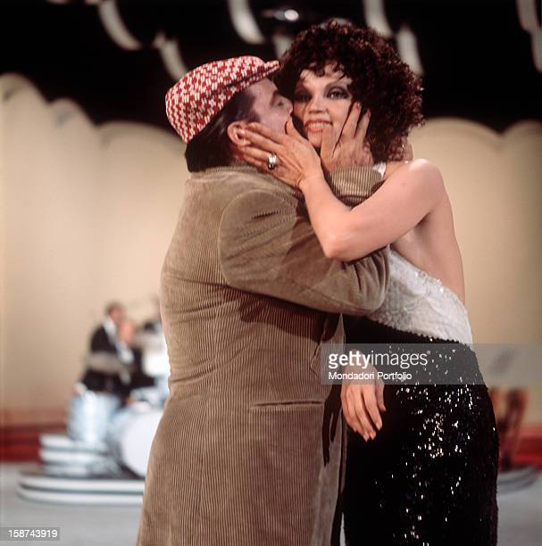 Italian comedy actor Carlo Dapporto kisses cuban actress Chelo Alonso the two artists are together involved in presenting the TV music show E perché...