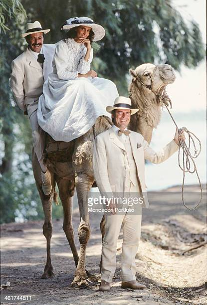 Italian comic actor Tullio Solenghi holding in his hand the rein of a dromedary on which Italian comic actors Massimo Lopez and Anna Marchesini sit...