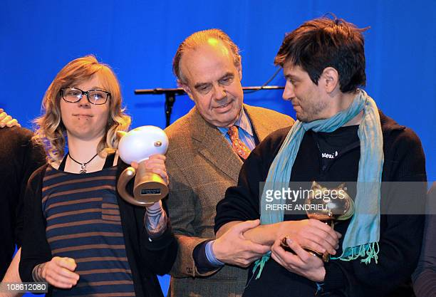 Italian comic book writer Manuele Fior and French Julie Maroh pose with their trophy after winning respectively the Fauve d'Or award of the best...
