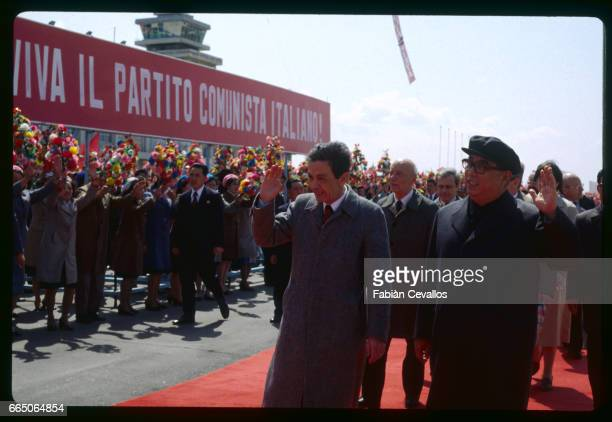 Italian Communist party general secretary Enrico Berlinguer is accompanied ny Kim Il Sung on an official visit to North Korea The two leaders wave to...