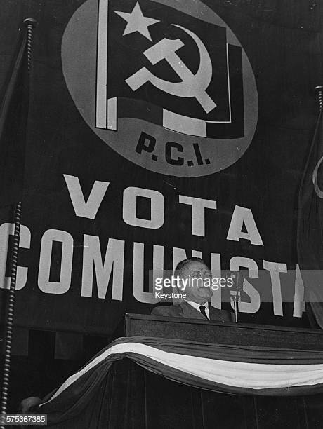 Italian Communist politician Palmiro Togliatti making an election speech in front of the Communist flag at Cathedral Square Milan May 6th 1956