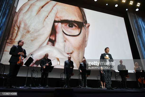 TOPSHOT Italian composer and conductor Andrea Morricone acknowledges applause after he conducted string ensemble Roma Sinfonietta playing Deborah's...