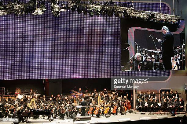 Italian composer Ennio Morricone of Italy conducts at the Medal Plaza on Day 3 of the 2006 Turin Winter Olympic Games on February 13 2006 in Turin...