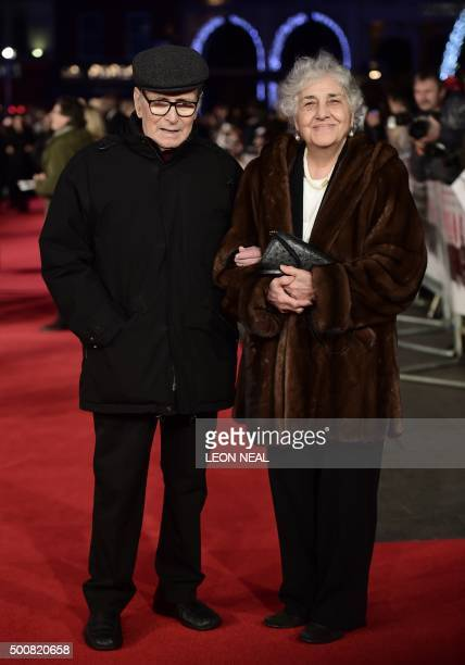 Italian composer Ennio Morricone poses with his wife Maria Travia on the red carpet of the European premiere of film 'The Hateful Eight' in London on...
