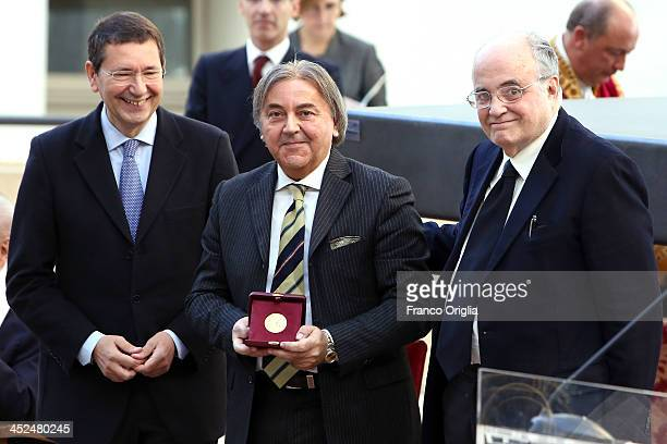 Italian composer Flavio Emilio Scogna receives a Vittorio De Sica Award from Mayor of Rome Ignazio Marino at Esedra di Marco Aurelio Hall on November...
