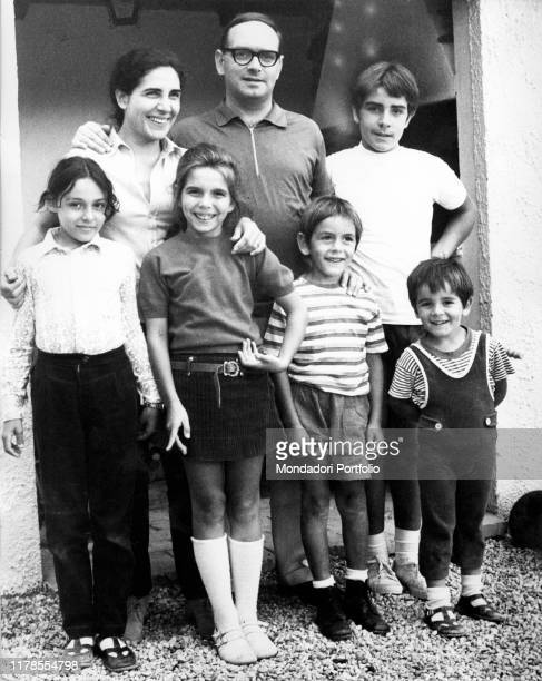 Italian composer musician conductor Ennio Morricone with his family his wife Maria Travia his sons Marco Andrea and Giovanni and his daugher...