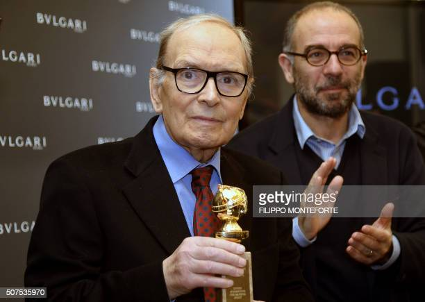 Italian composer orchestrator conductor Ennio Morricone poses with the 2016 Golden Globe he received for the soundtrack of Quentin Tarantinos movie...