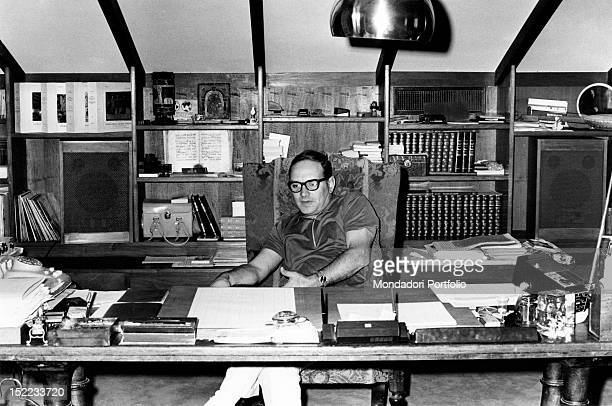Italian conductor and composer Ennio Morricone sitting in his office Rome 1970s