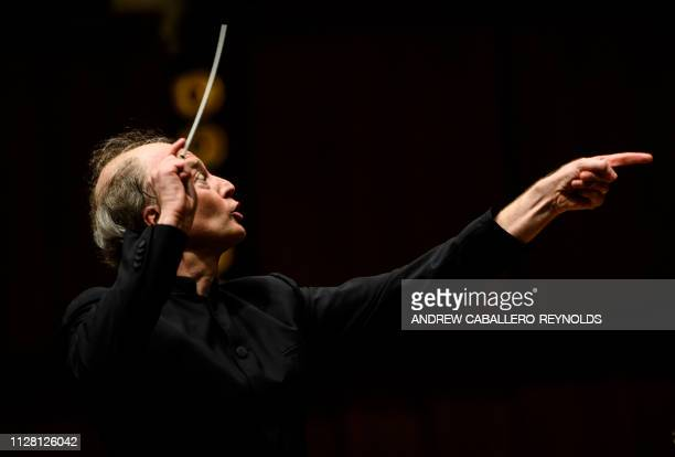 Italian conductor Gianandrea Noseda gestures as he conducts the National Symphony Orchestra during a concert at the John F Kennedy Center for the...
