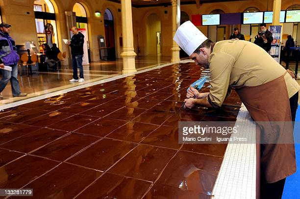 Italian confectioners Giuseppe Sartoni and Mirco Della Vecchia making the biggest chocolate tablet in the world awarded by the Guinness World Records...