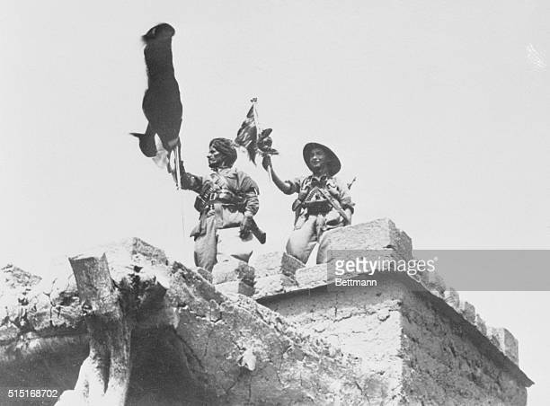 Italian Conquest in Somaliland A native and a regular Italian soldier plant their standards on one of the abutments of a captured bridge in Jinch in...