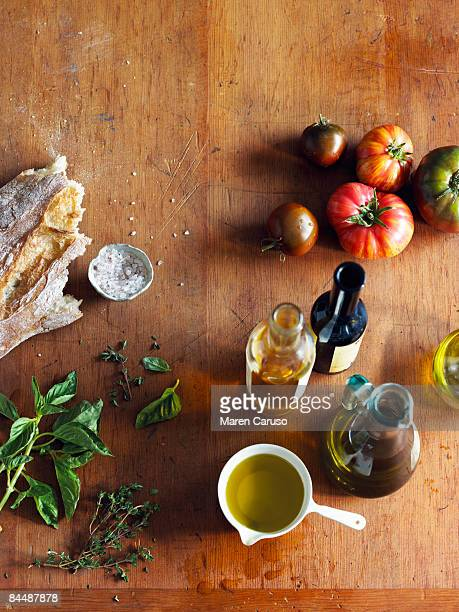 italian cooking ingredients on a cutting board - mediterrane kultur stock-fotos und bilder