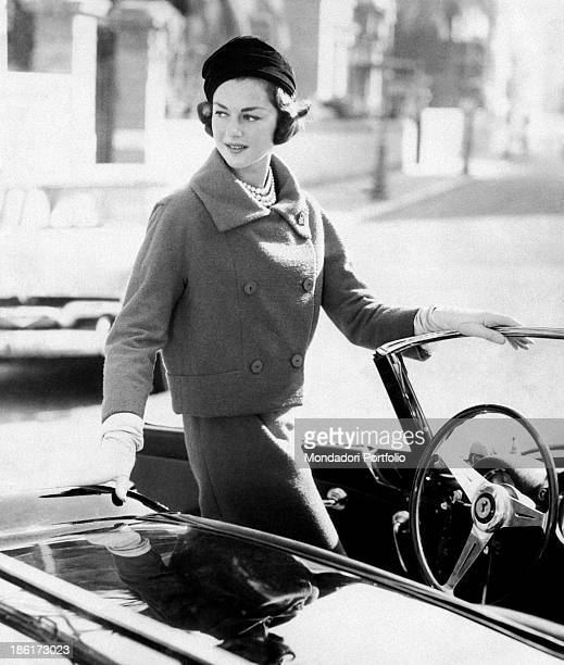 Italian countess model and fashion editor Consuelo Crespi born Consuelo O'Brien O'Connor Crespi gets in a convertible car dressed in a Chanel...
