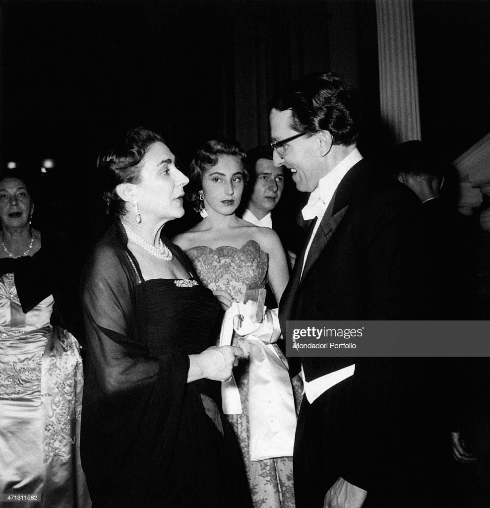 Italian countess Wally Toscanini Castelbarco, famous Italian conductor Arturo Toscanini's daughter, is with her daughter Emanuela Castalbarco and talks with German opera director Wolfgang Wagner, Richard Wagner's grandson; they attend the reopening of Vienna Opera House, rebuilt following 1945 fire; after the performance of Beethoven's Fidelio, a ball is held in the hall of Philarmonics. Vienna (Austria), November 5, 1955.