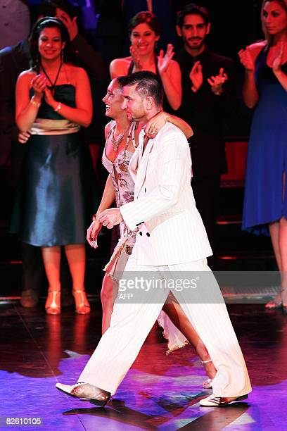 Italian couple mauro Sompa and Sara Masi celebrate taking seventh place in the 6 Tango Festival of Buenos Aires in Buenos Aires on August 30, 2008....