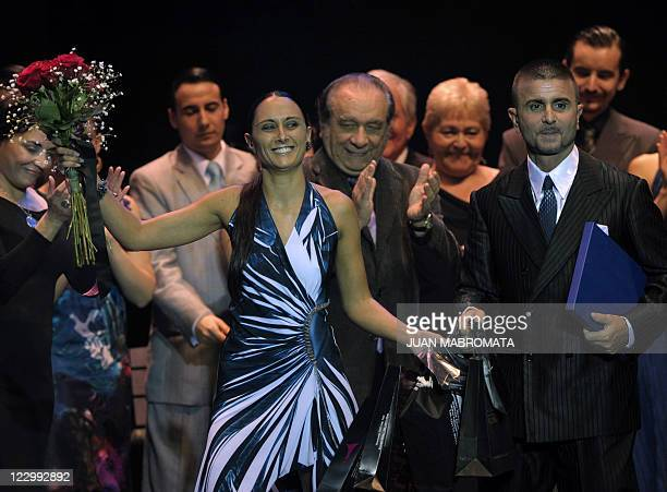 Italian couple Mauro Zompa and Sara Masi celebrate after getting the fourth place in the Tango Salon competition during the 9th Tango Dance World...