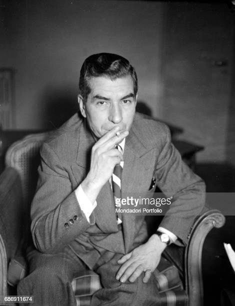 Italian criminal Lucky Luciano in a hotel smoking a cigarette Rome 12th December 1948