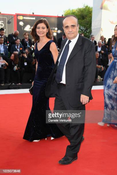 Italian Culture Minister Alberto Bonisoli and guest walk the red carpet ahead of the opening ceremony and the 'First Man' screening during the 75th...