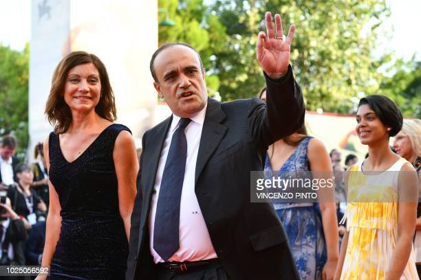 Italian Culture Minister Alberto Bonisoli arrives for the opening ceremony and the premiere of the film 'First Man' presented in competition at the...
