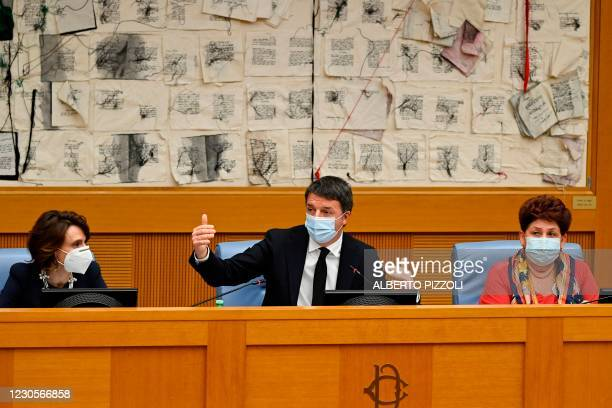 Italian current Senator, former premier and head of the political party 'Italia Viva' , Matteo Renzi gestures as he holds a press conference with...