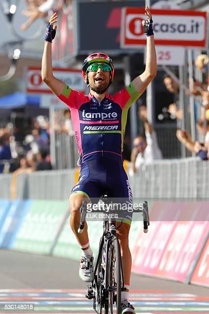 Italian cyclist Diego Ulissi of Lampre - Merida celebrates as he crosses the finish line at the end of the fourth stage during the 99th Giro...