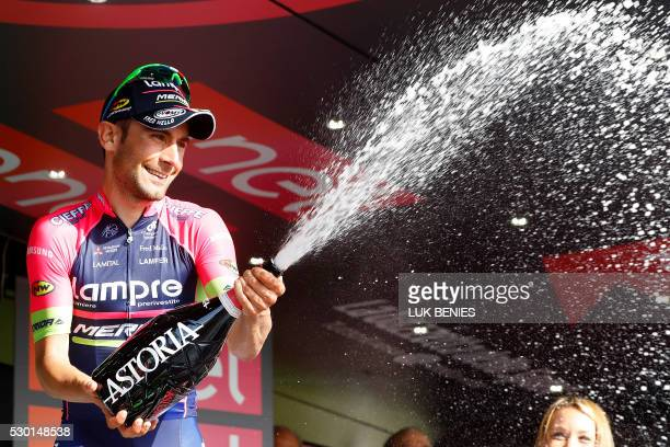 Italian cyclist Diego Ulissi of Lampre Merida sprays champagne as he celebrates on the podium after winning the fourth stage of 200 km from Catanzaro...