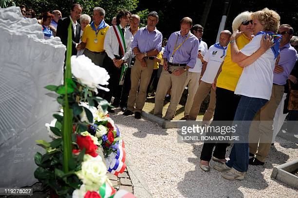 Italian cyclist Fabio Casartelli's mother is comforted as she attends a ceremony with French Socialist Party MP and contender for the party's...
