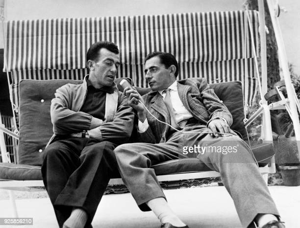 Italian cyclist Fausto Coppi interviews his friend French cyclist Louison Bobet on May 31 1957 in Montecatini Terme Italy