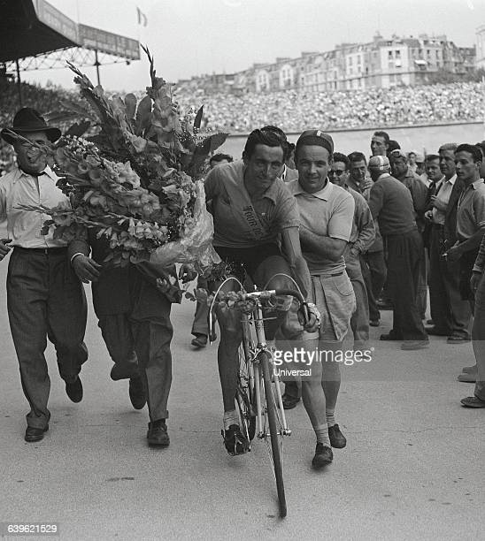 Italian cyclist Fausto Coppi makes a victory lap in the Parc des Princes after winning the 1949 Tour de France The 21st and final stage was between...