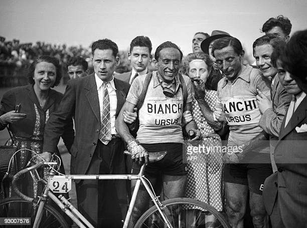 Italian cyclist Fausto Coppi poses with his brother Serse Coppi who has just won the ParisRoubaix race on April 18 1949 Fausto Coppi one of the most...