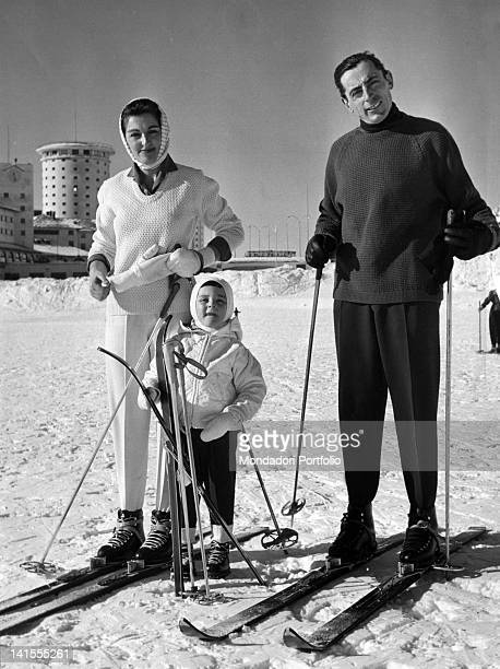 Italian cyclist Fausto Coppi posing on a ski slope of Sestriere with his son Angelo Fausto Giulia Occhini the White Lady Sestriere January 1959