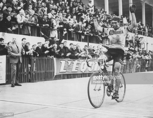 Italian cyclist Felice Gimondi throws up his arms in celebration after crossing the line to win the ParisRoubaix one day race Mandatory Credit...