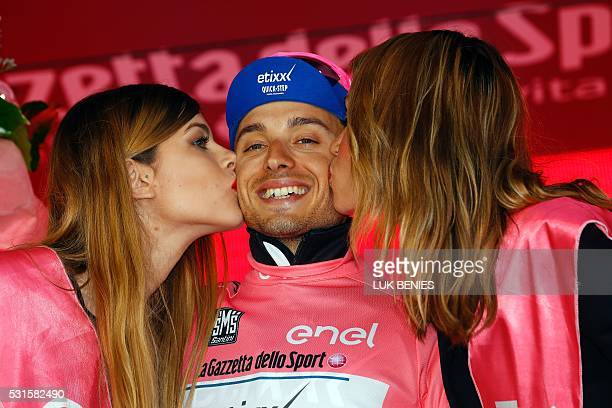 Italian cyclist Gianluca Brambilla of Etixx Quick Step team celebrates on the podium after winning the pink jersey of leader in the overall ranking...
