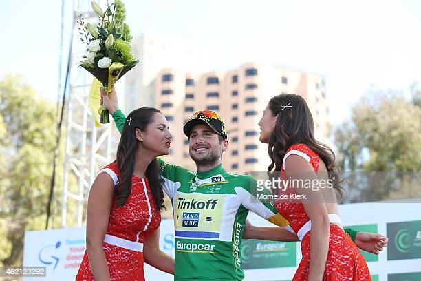 Italian cyclist Manuele Boaro of Tinkoff Saxo celebrates on stage after being awarded the Most Competetive Rider jersey after Stage 6 of the 2015...