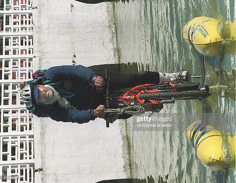 Italian cyclist Marco Banchelli demonstrates a 'waterbike' in Rani Pokhari, a historical pound in Kathmandu, 01 January. Banchelli will conduct such dmonstrations in lakes around Nepal including Phewa Lake in Pokhara from 4-7 Jan.