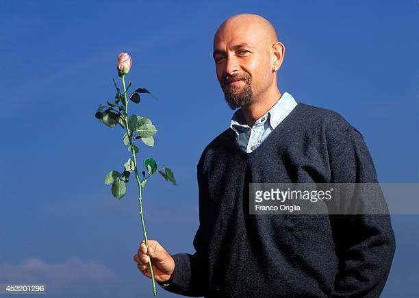 Italian cyclist Marco Pantani, Tour de France and Giro d'Italia race winner in 1998, holds a rose as a symbol of the Giro d'Italia race at the...