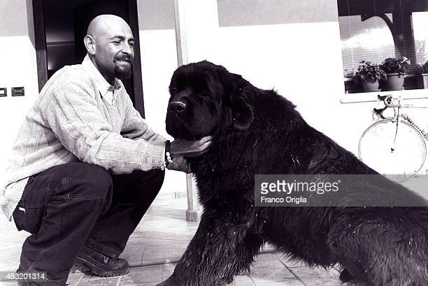 Italian cyclist Marco Pantani, Tour de France and Giro d'Italia race winner in 1998, plays with his dog at his family house on November 8, 1998 in...