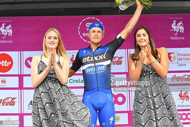 Italian cyclist Matteo Trentin of the team Etixx QuickStep celebrates on the podium after winning the fourth stage from Aubel to Herstal of the Tour...