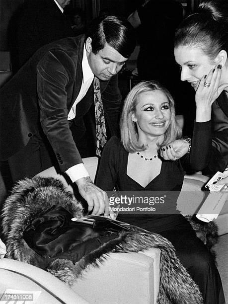 Italian dancer and presenter Raffaella Carrà Italian television author Gianni Boncompagni and his secretary celebrating the attainment of Agrodolce...