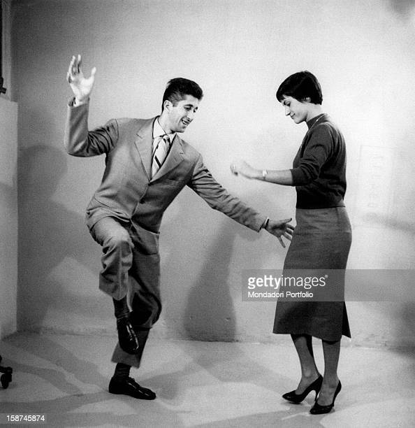 Italian dancer Bruno Dossena and one of his students showing some rock 'n roll dance steps Italy 1956