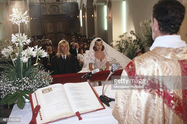Italian dancer showgirl and actress Carmen Russo and Italian dancer and choreographer Enzo Paolo Turchi sitting in front of the altar on the day of...